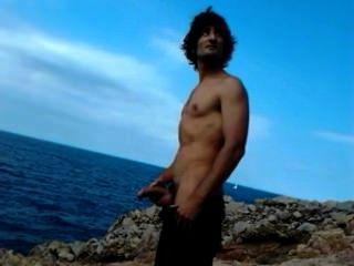 बेल समुद्र तट पर Pissing ग्रिस